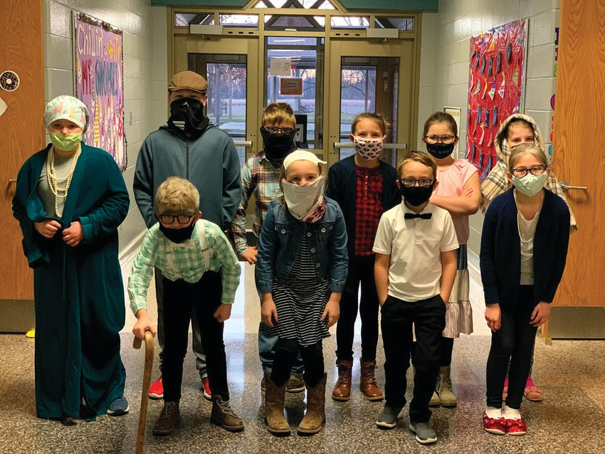 New Market Elementary students dressed up as 100-year-olds to celebrate the 100th day of in-person school Thursday.