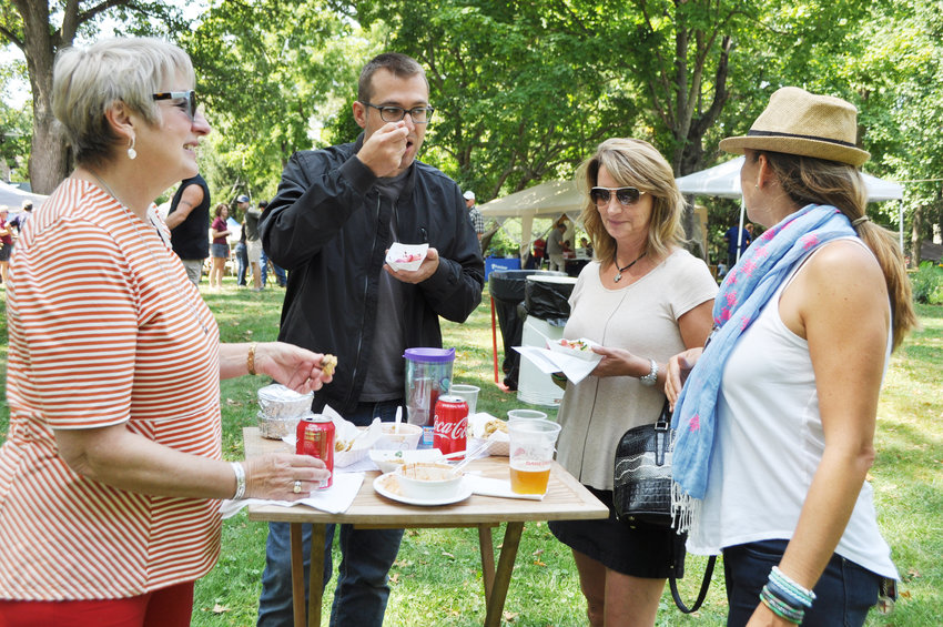Rees Olander, left, visits with family members Emerson Olander, Sara Olander and Megal Olander at Taste of Montgomery County on the grounds of the General Lew Wallace Study & Museum.