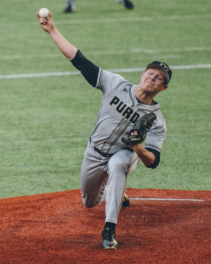 Crawfordsville's Trent Johnson fires a pitch to the plate in a game early last season for Purdue University. Johnson is entering his senior season for the Boilermakers.
