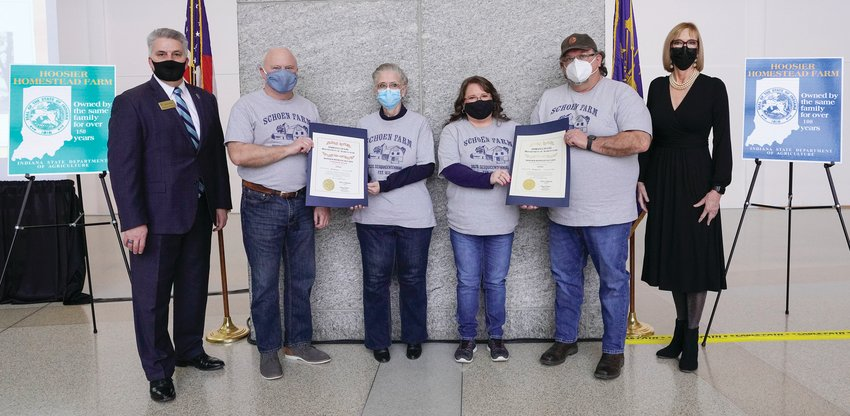 Members of the Shoen family accept a Hoosier Homestead award.