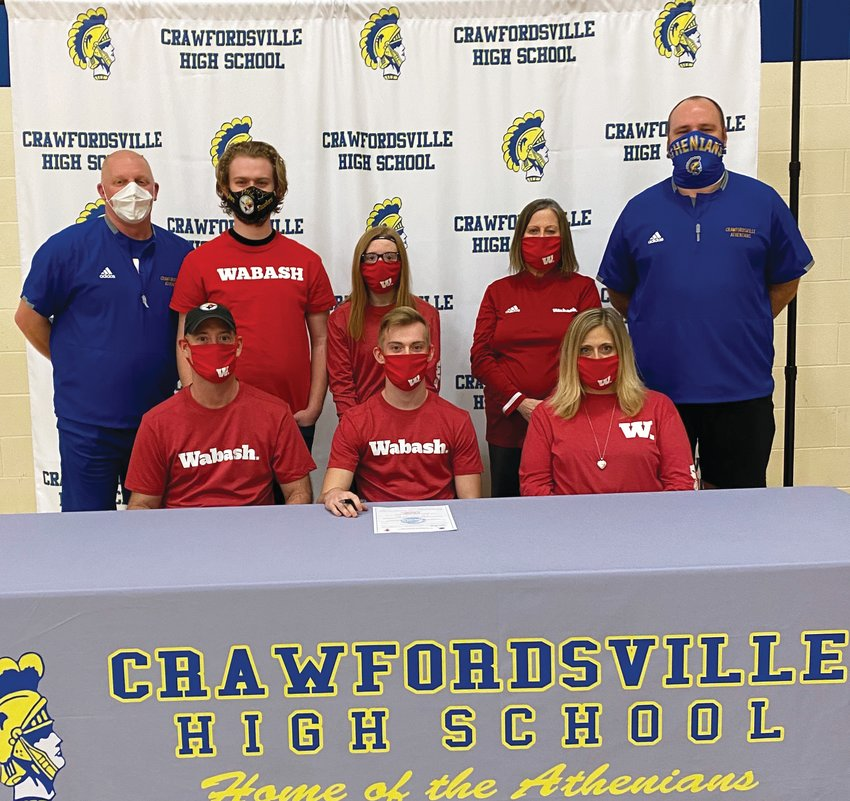Crawfordsville football player and senior Andrew Martin will continue his career at Wabash College in the fall. PICTURED: Front Row L-R Andrew's father, Jesse Martin, Andrew, mother, Stephanie Wethington. Back Row L-R Crawfordsville coach Kurt Schlicher, brother, Peyton Suiter, sister, Madison Martin, grandmother, Ginger Collins, and assistant football coach Sean Gerold.