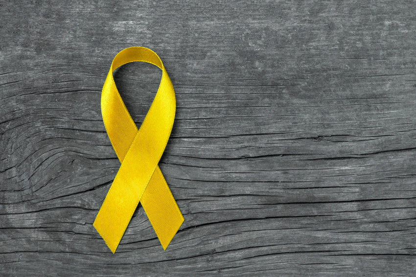 The yellow ribbon represents suicide awareness and prevention and survivors.