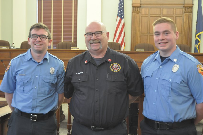 Gavin Waddell, right, stands with his father Buck and brother Wyatt in the City Building on Wednesday. Gavin Waddell was just sworn in as a Crawfordsville firefighter/EMT.