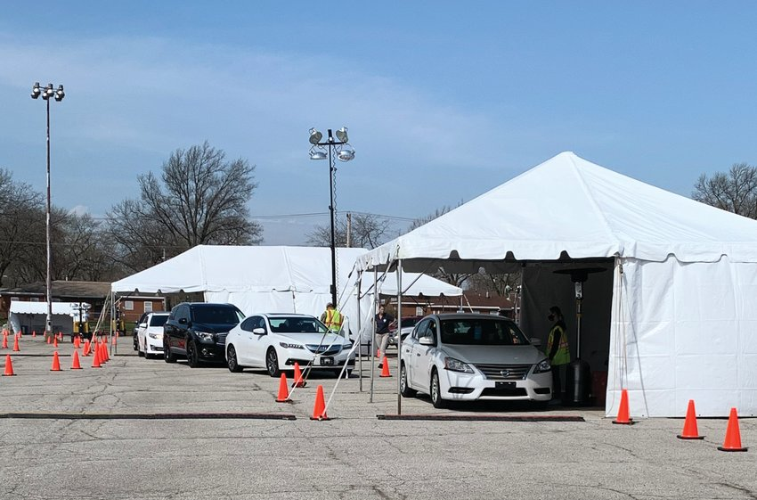 Cars line up at a mass COVID-19 vaccination site in Gary. Montgomery County Emergency Management Agency Director Shari Harrington deployed with a statewide task force to help run the site.