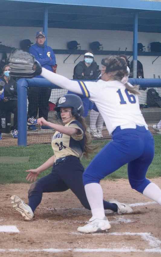 Fountain Central's Jerzi Hershberger slides safely into home plate in the Mustangs win at Crawfordsville on Thursday.