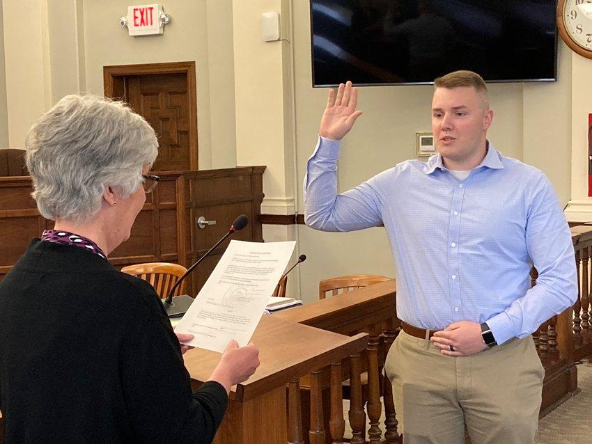 Crawfordsville Police Officer Dakota Carlton takes the oath from Clerk-Treasurer Terri Gadd at the City Building on Wednesday.