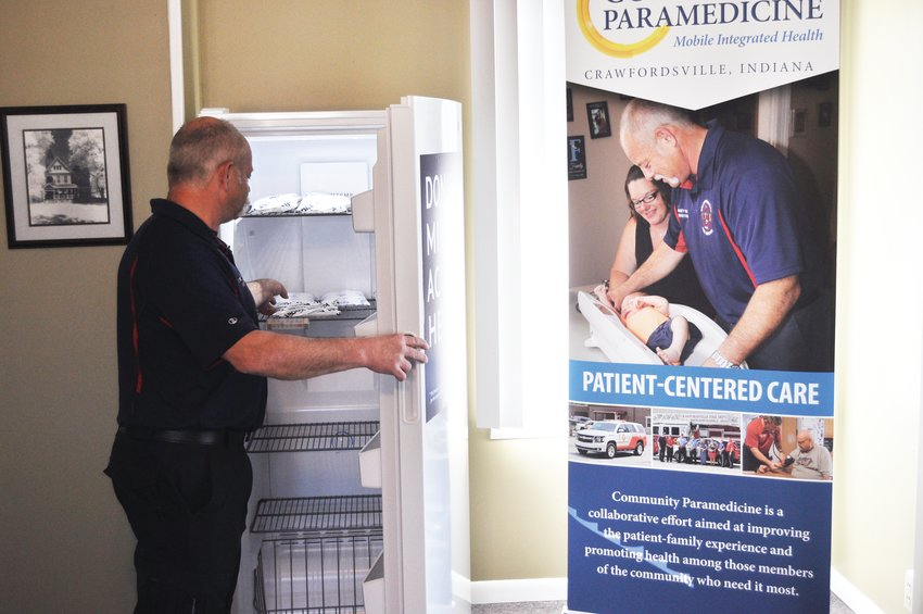 Darren Forman, community paramedic and coordinator of the Project Swaddle program, opens a freezer Monday that will store donor breastmilk at the Crawfordsville Fire Department Paramedicine Center. The department partnered with nonprofit The Milk Bank to provide a dropoff site for donor mothers.