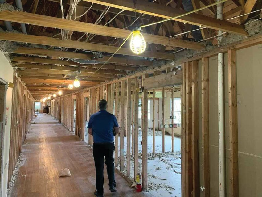 Marc Bonwell, Montgomery County building and zoning administrator, walks through the future Montgomery County Annex. The former Williamsburg Health Care facility is being renovated into county offices and a government meeting space.