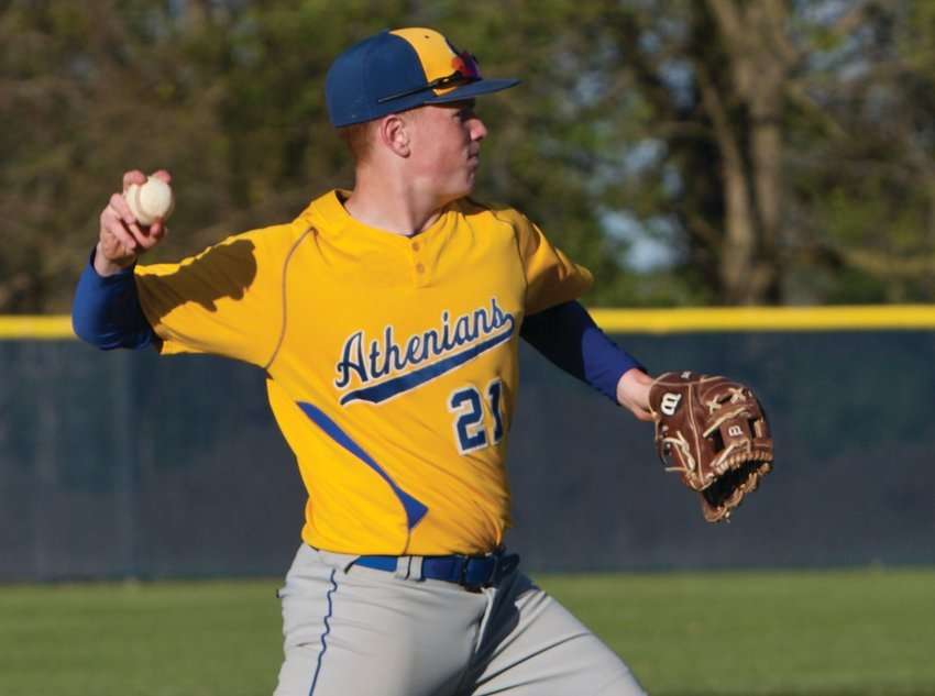 Crawfordsville's Kale Wemer fires a ball to first base in the Athenians come from behind win at North Montgomery on Wednesday.