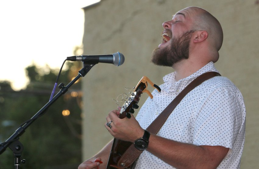 Colby Green performs in the first season of the Second Friday Pike Place Community Concert & Food Festival in 2019. The series returns July 9 with headliner War Radio.