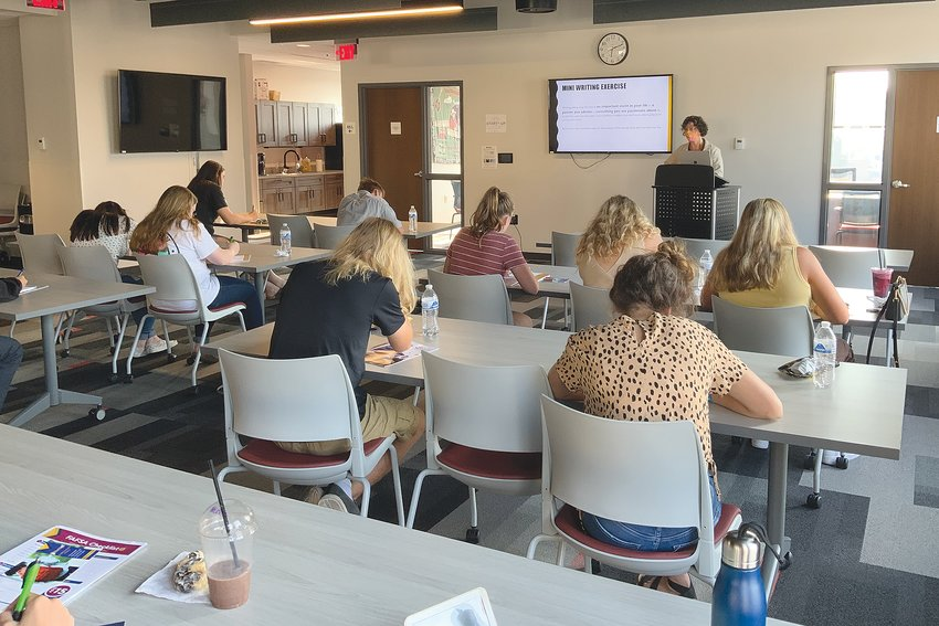 Rising high school seniors take notes Sunday during a scholarship workshop at Fusion 54 in downtown Crawfordsville. The workshop was presented by the Montgomery County Community Foundation.