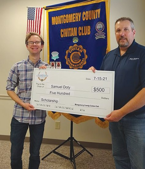 Sam Doty, left, receives the first-ever Montgomery County Civitan Club scholarship.