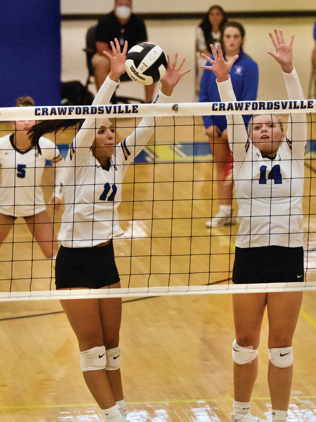 Crawfordsville senior Alyx Bannon skies for a block on Tuesday night against Crawfordsville.