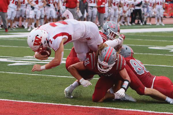 Wabash junior quarterback Liam Thompson accounted for four touchdowns, including this rushing touchdown in the first quarter.