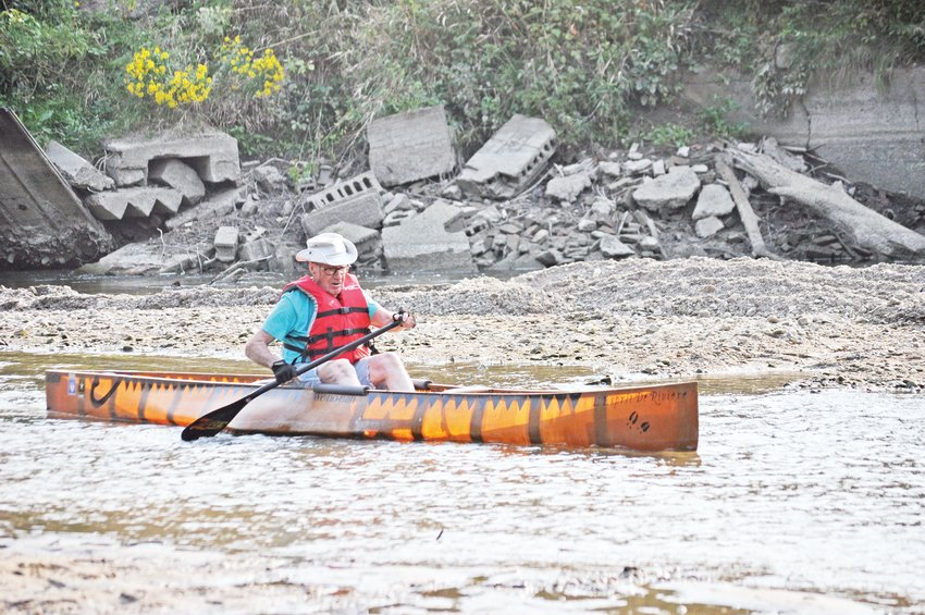 """Bob Stwalley, 90, paddles through the old lowhead dam site on Sugar Creek. The dam was removed last week, and Stwalley said there was about only about 4 inches of water in that part of the creek. In a letter submitted to the Journal Review, Stwalley wrote: """"I wish to thank all involved in the removal of the last dam on Sugar Creek. Mayor Todd Barton and his administration, the Friends of Sugar Creek, Dr. Jerry Sweeten and his staff and the heavy equipment operators of Walden's. From start to finish, four days. Fantastic. I dedicate this paddle through the old dam site to three men and one woman who are no longer with us: Roger Beach, Don Bickel, Dr. Lewis Runnels and Patt Oakley. Also to Bob Demoret, my part-time paddling partner and all the USA paddlers. May this beautiful river now forever flow free."""""""