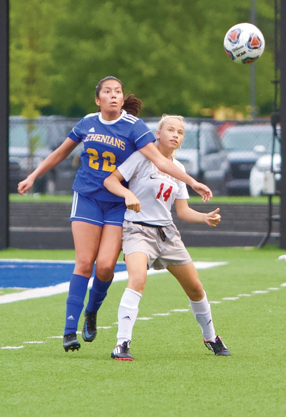 Crawfordsville's Eliana Salas Olvera and Southmont's Olivia Snapp fight for position.