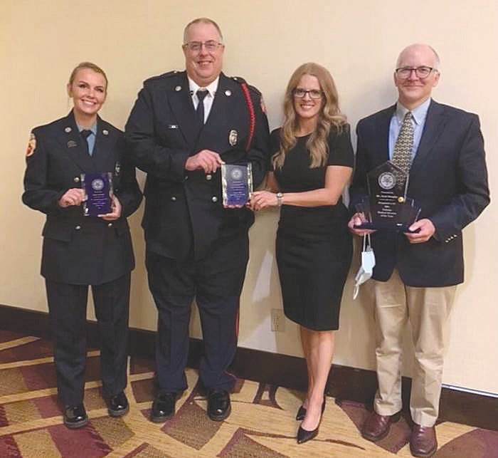 Pictured, from left, are Firefighter and Paramedic Dayna Leonard, Firefighter and Paramedic Joe Crane, Early Intervention Specialist Rachel Kenner and Dr. Scott Douglas, who were honored Sunday at the IFCA's Indiana Emergency Response Conference for their contributions to the Crawfordsville community.