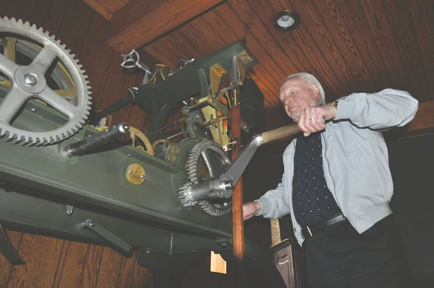 Hubert Danzebrink winds the old Montgomery County Courthouse clock in 2018. Danzebrink, who rebuilt the clock, died Sunday.