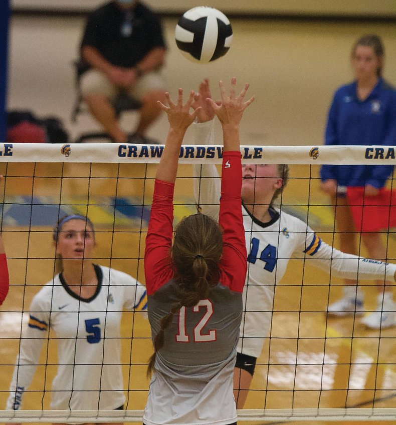 Crawfordsville's Macy Bruton spikes a ball over the net against Southmont on Monday.