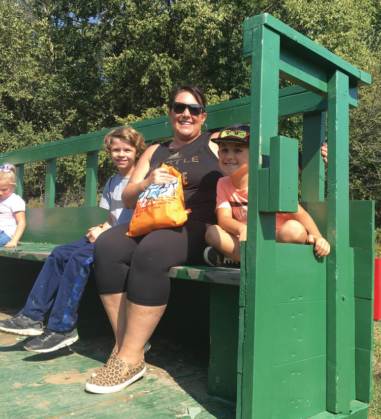 Amie Bowen and Bentlee with her son on the wagon ride.