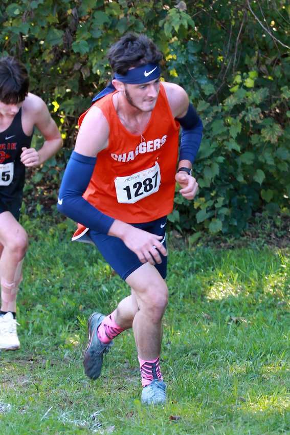 Elijah McCartney of North Montgomery advanced to the New Prairie Semi-State by finishing 13th in the Harrison XC Regional with a time of 17:16.08.  He is photographed on the final hill of the race.