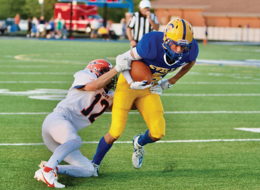 Evan Chaney fights for extra yards against North Montgomery
