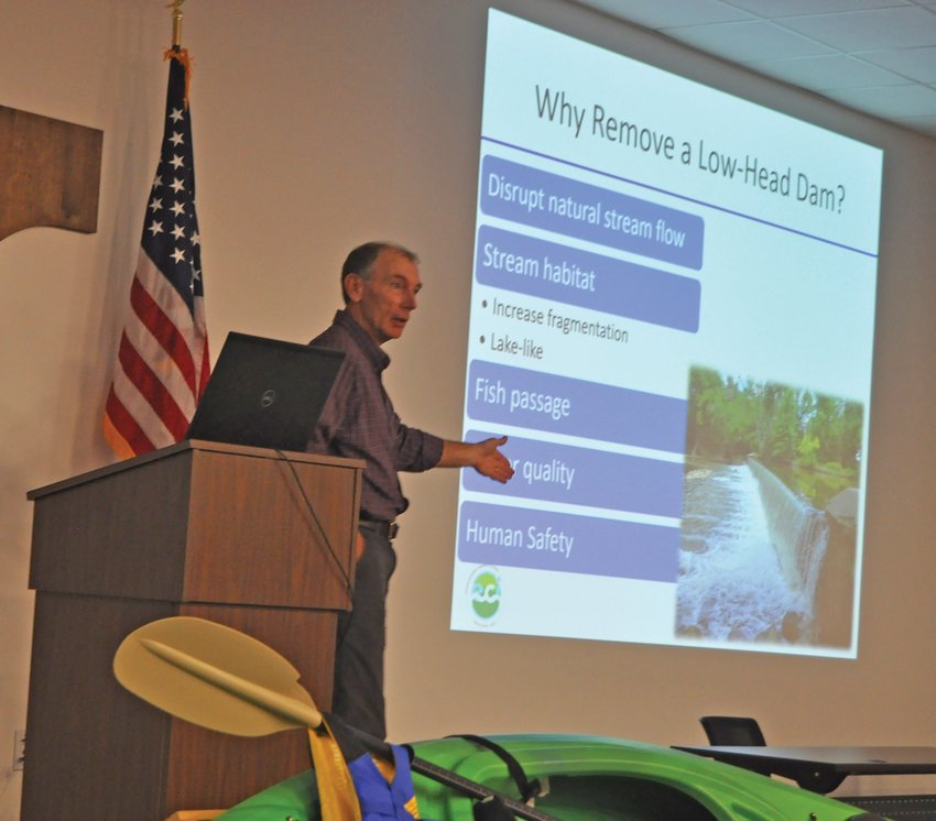 Dr. Jerry Sweeten, senior ecologist for Ecosystems Connections Institute, speaks about the Sugar Creek lowhead dam removal during the Friends of Sugar Creek annual meeting at the Hoosier Heartland State Bank Success Center on Thursday.