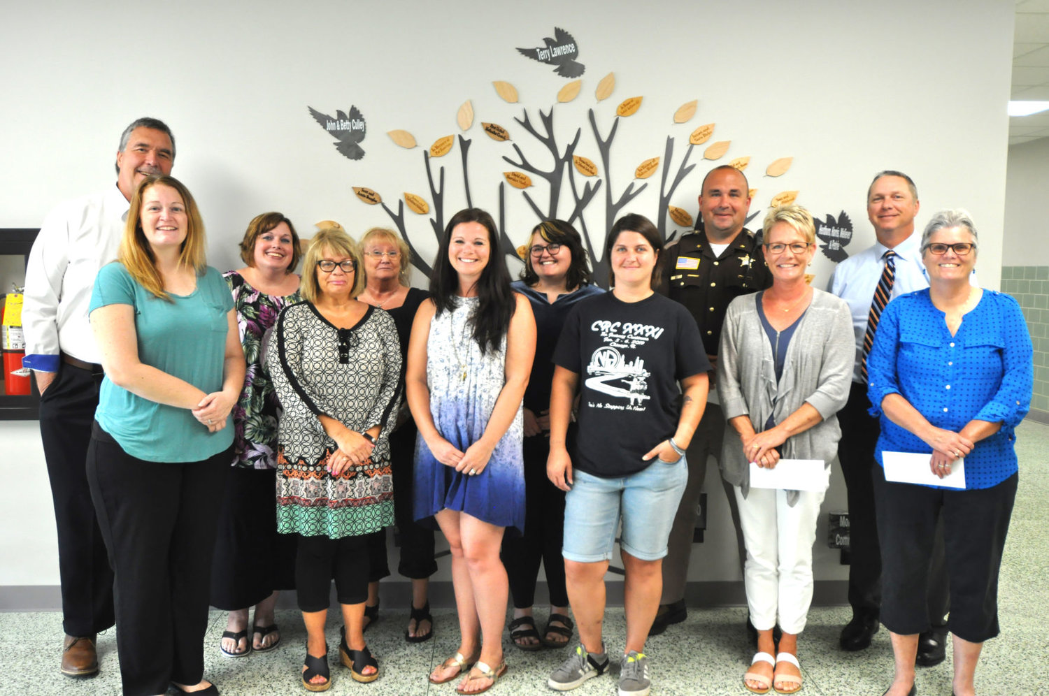 Recipients of Drug Free Montgomery County Coalition mini-grants gather at the Montgomery County Youth Service Bureau for a ceremony.