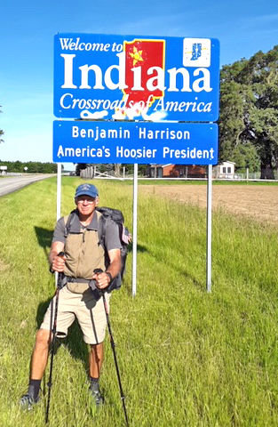 Air Force veteran William Shuttleworth, pictured here at the Indiana state line, is walking across the country to raise awareness of veteran's issues. Shuttleworth stopped in Crawfordsville on Friday.