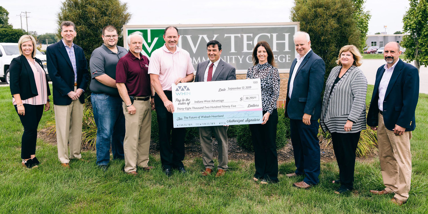 Members from IWA, Ivy Tech Community College Lafayette, Bane-Welker and Co-Alliance accept a check from the Wabash Heartland Innovation Network. Pictured, from left, are Andrea Schwartz, Ivy Tech Community College; Dr. Todd Roswarski, Ivy Tech Community College; Tyler Wilson, Bane-Welker; Greg Morrison, Davis Morrison Realty; Brad Monts, Hoosier Heartland State Bank; Dr. David Bathe, Ivy Tech Community College; Stephanie Merrill, Ivy Tech Community College; Jeff Griffeth, Co-Alliance; Dr. Colleen Moran, North Montgomery Schools; Kraig Bowers, Ivy Tech Community College.