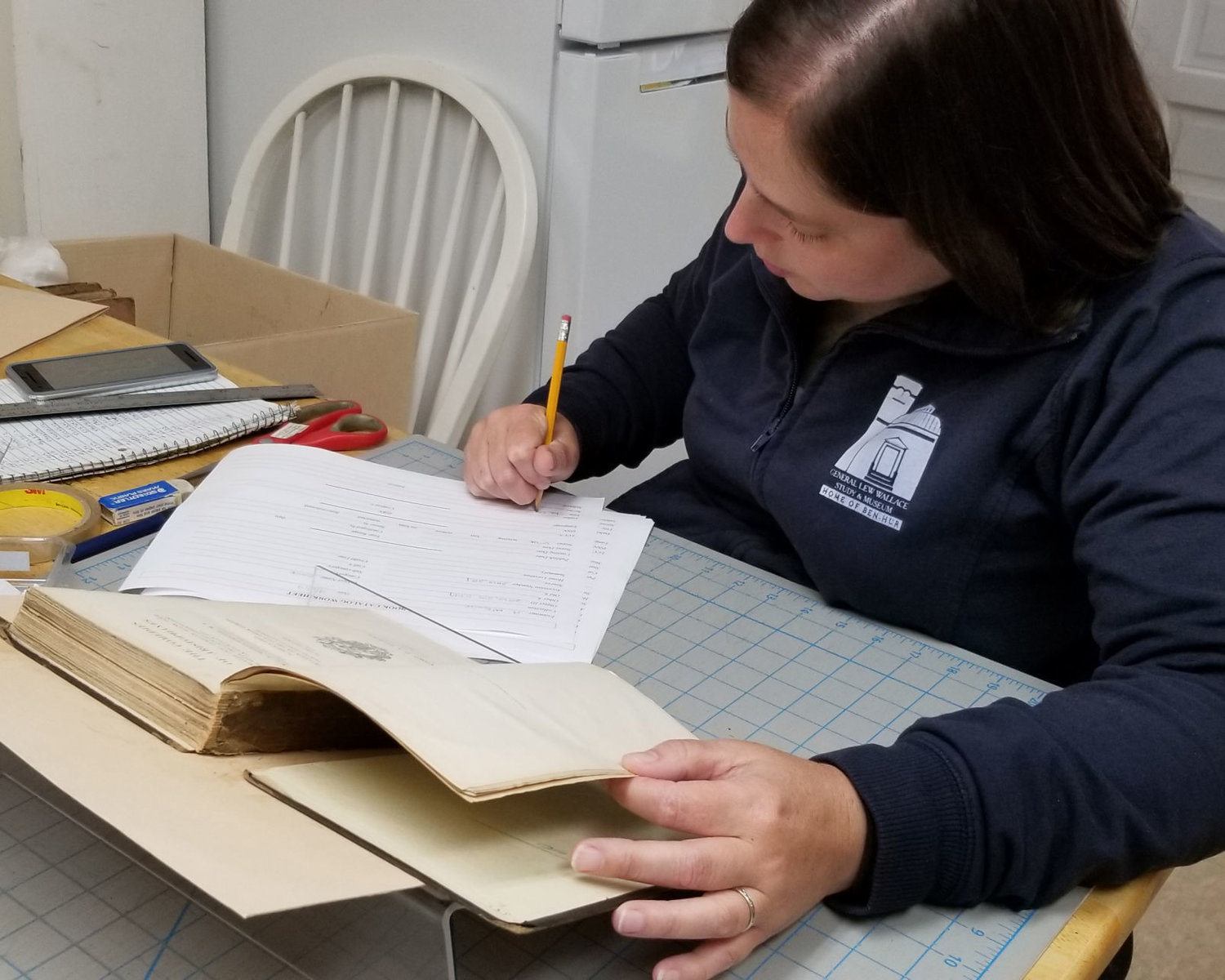 Associate director Amanda McGuire of the Gen. Lew Wallace Study and Museum works on book conservation.