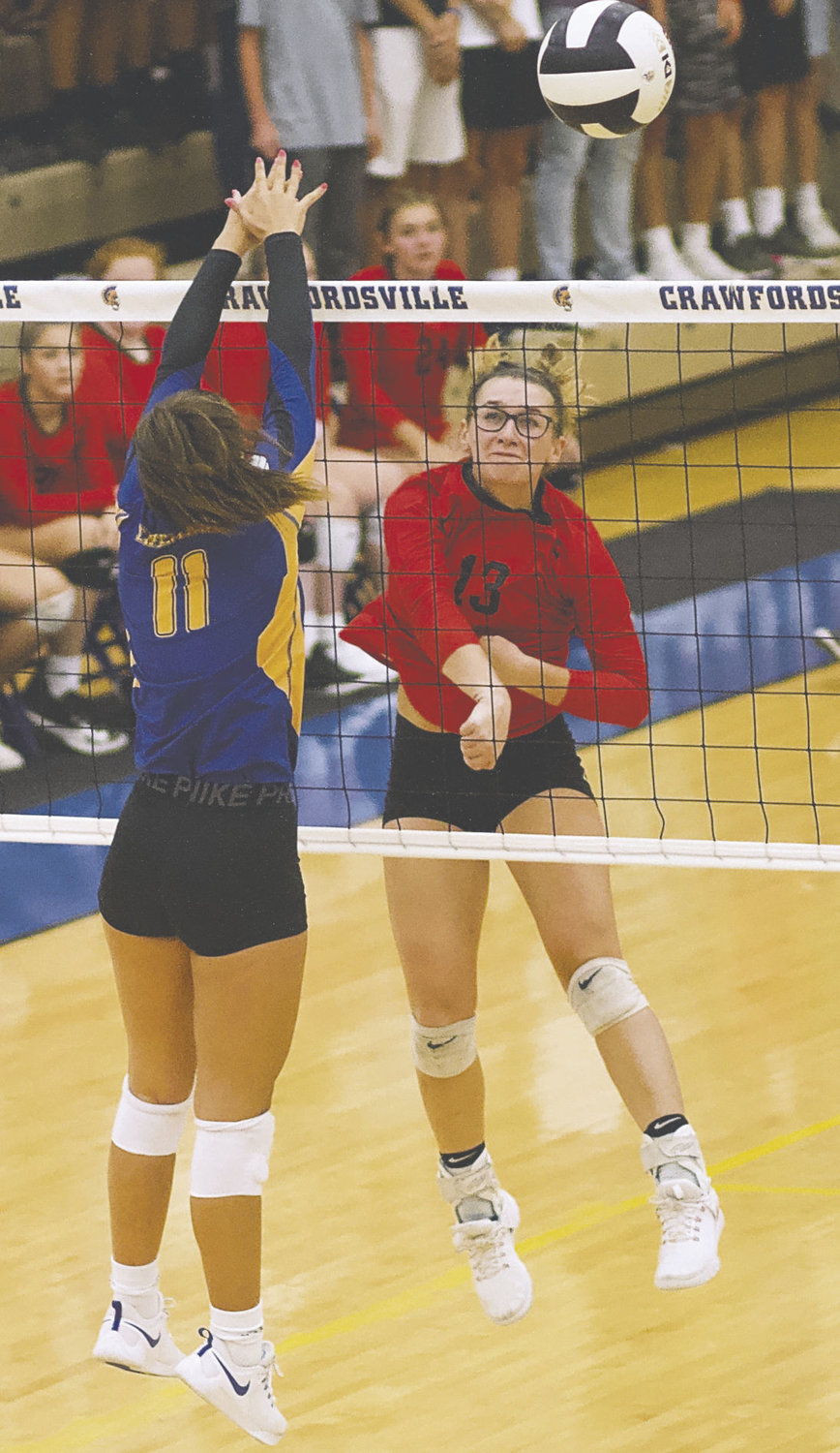 Southmont's Kaley Remley hits over Crawfordsville's AlyxBannon in a game earlier this season.