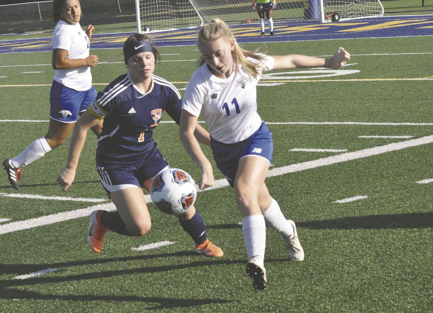 North Montgomery's Sidney Campbell battles with Frankfort' Peyton Myers. Campbell scored the Charger's first goal in a 3-1 win over the Hot Dogs.