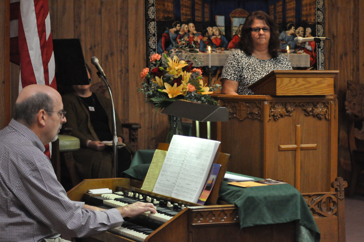 Kathy Addler listens as her husband, Ron, plays the organ Sunday during the final worship service at Milligan Memorial Presbyterian Church. The land for the building was donated in the 1890s by Gen. Lew and Susan Wallace.