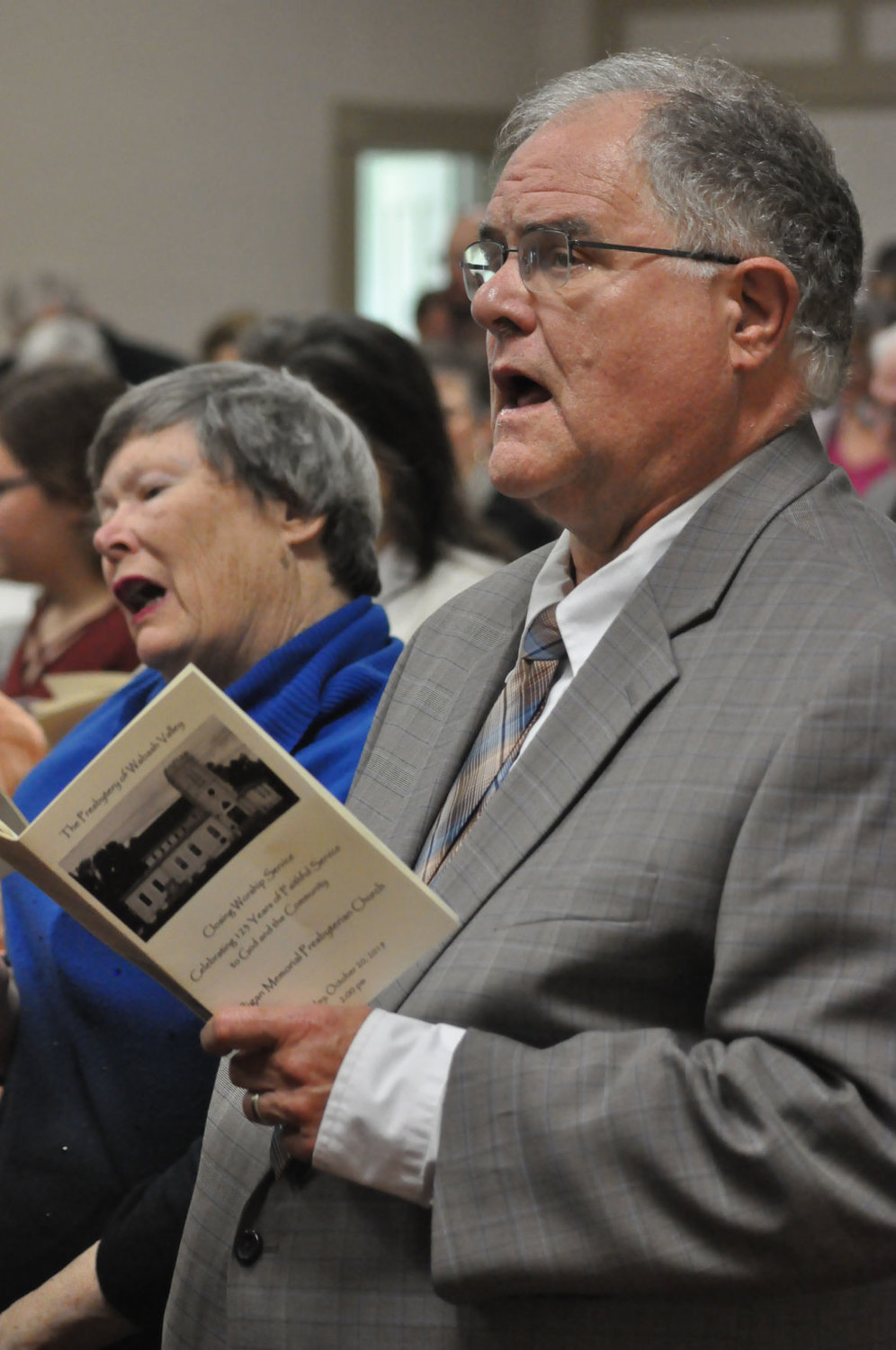 Mark Strothman and his wife, Sharon Maddox, sing during the final worship service Sunday at Milligan Memorial Presbyterian Church. Strothman was pastor of the church in the 1980s.