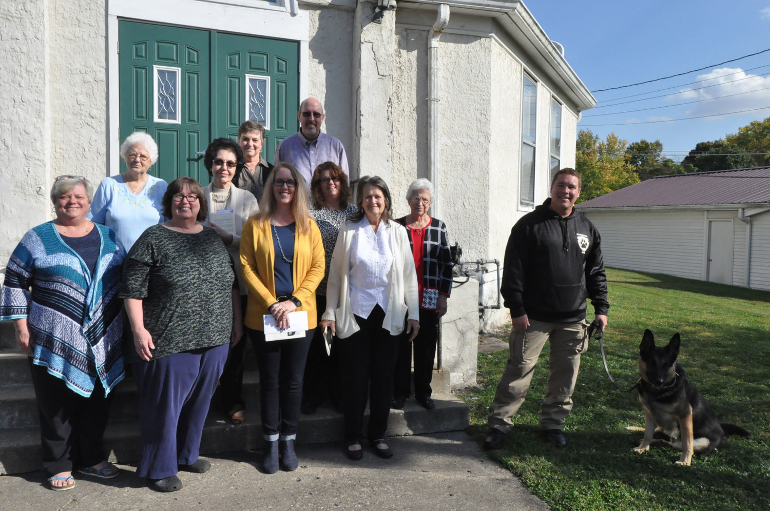 Recipients of funds from Milligan Memorial Presbyterian Church pose for a photo with church members Sunday after the final service. The church donated money to five groups.