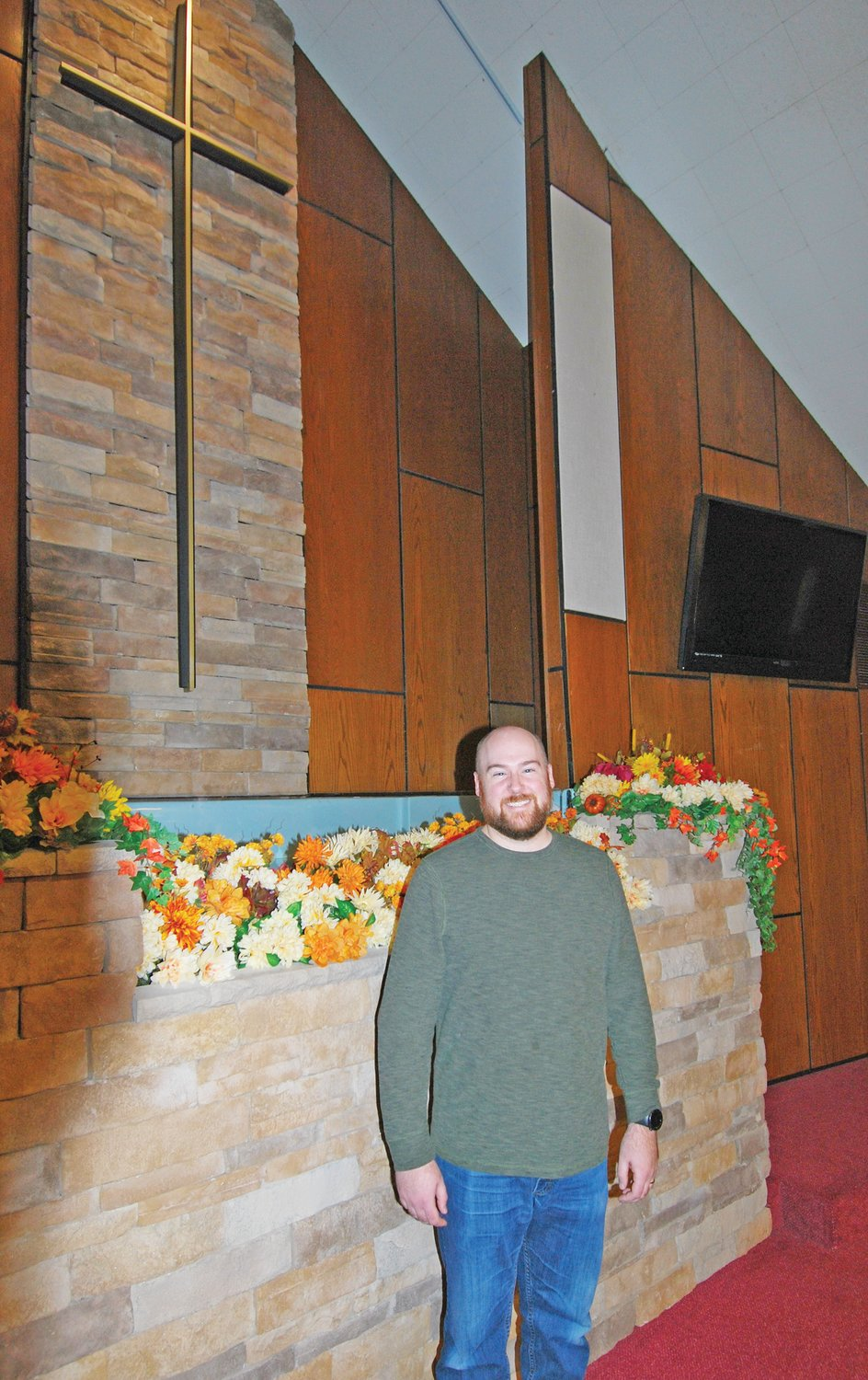 Wayne Wilkinson stands in the sanctuary of Woodland Heights Christian Church. Wilkinson recently began duties as worship minister.