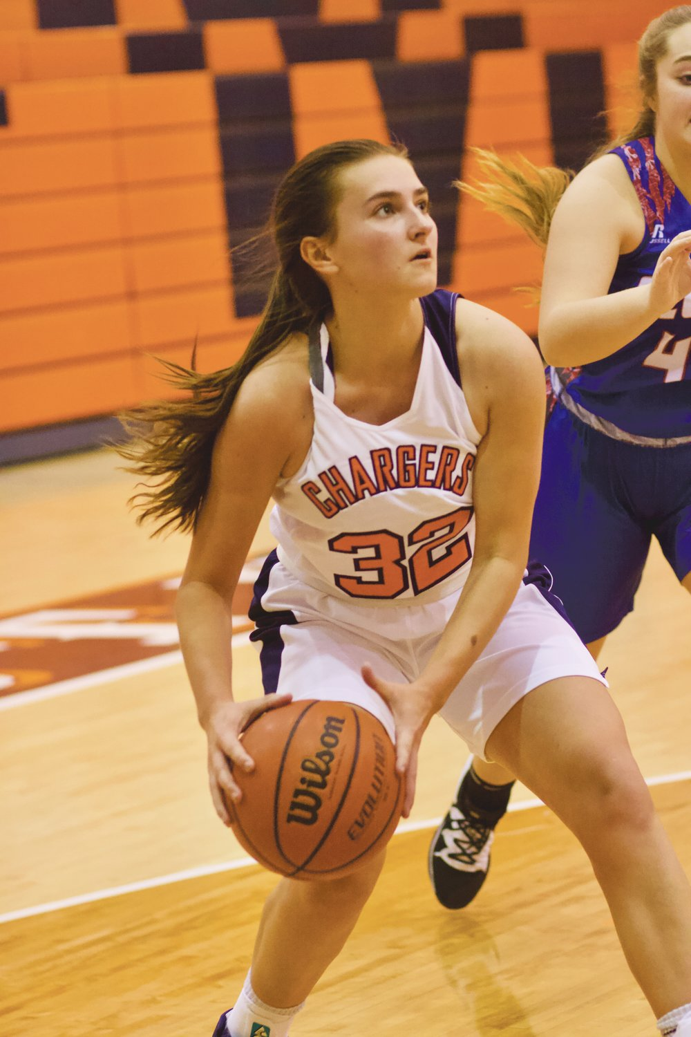 North Montgomery senior Emily Sennett scored 12 points in the Chargers 54-28 win over Elwood on Tuesday.