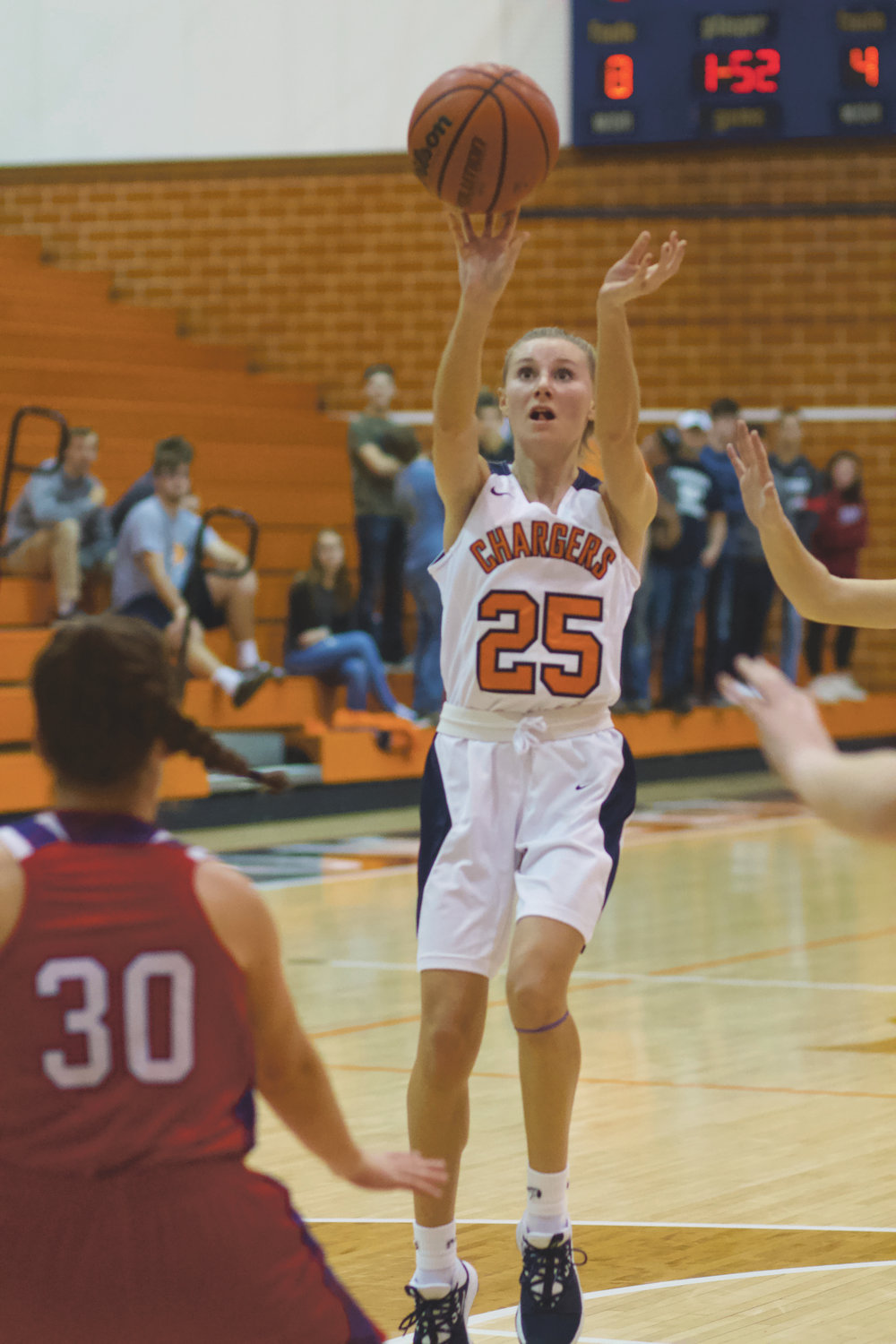 North Montgomery's Grace McClaskey fires up a shot in the Chargers' loss to Western Boone.