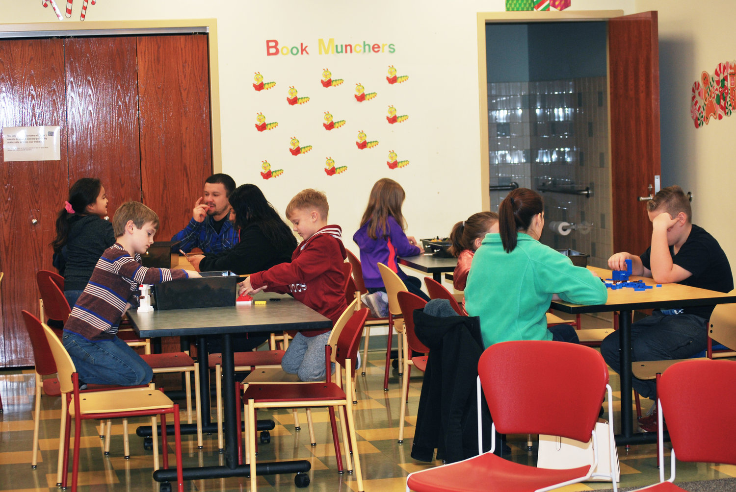 Lego Club getting together at the Public Library to create certain objects based on challenges given to them