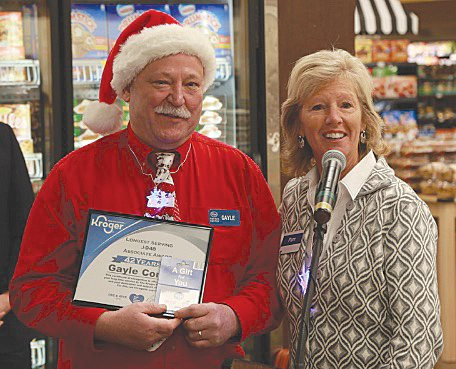 Gayle Conway, left, the longest-serving employee at Kroger South, poses with Pam Matthew, Kroger central division president.