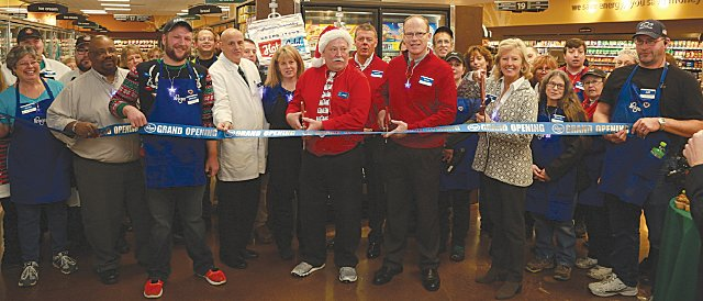 The Crawfordsville Kroger team cuts the ribbon Wednesday morning.