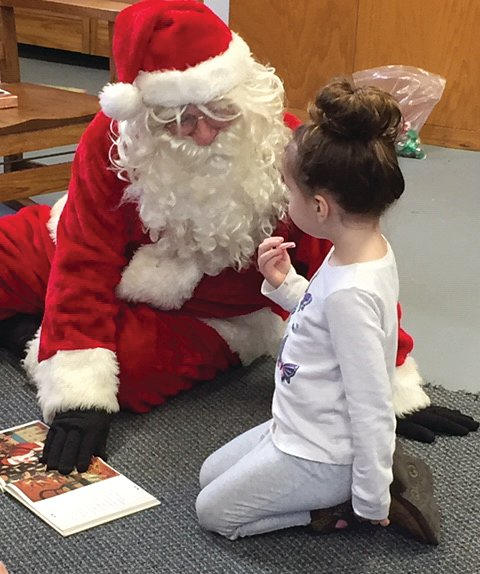 Waveland Public Library celebrated Christmas with a visit from Santa. Alyvia Linthicum can