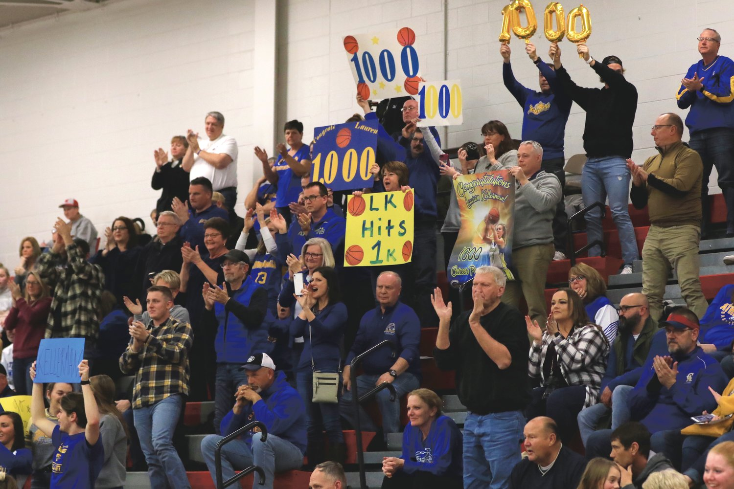 The Crawfordsville cheering section congratulates Lauren Kellerman on eclipsing the 1,000-point scoring mark.