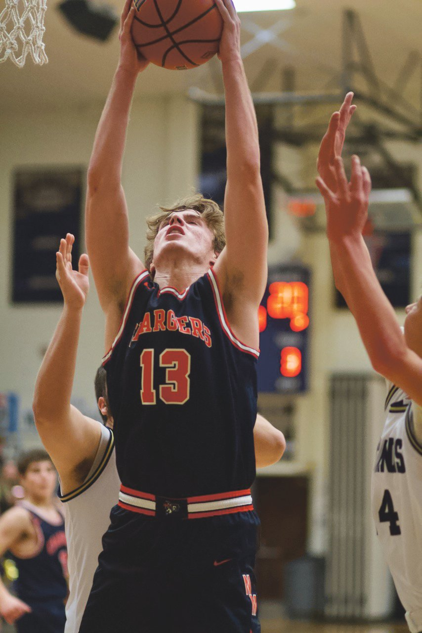 Zak Searle battles for a rebound in a game earlier this season for North Montgomery.