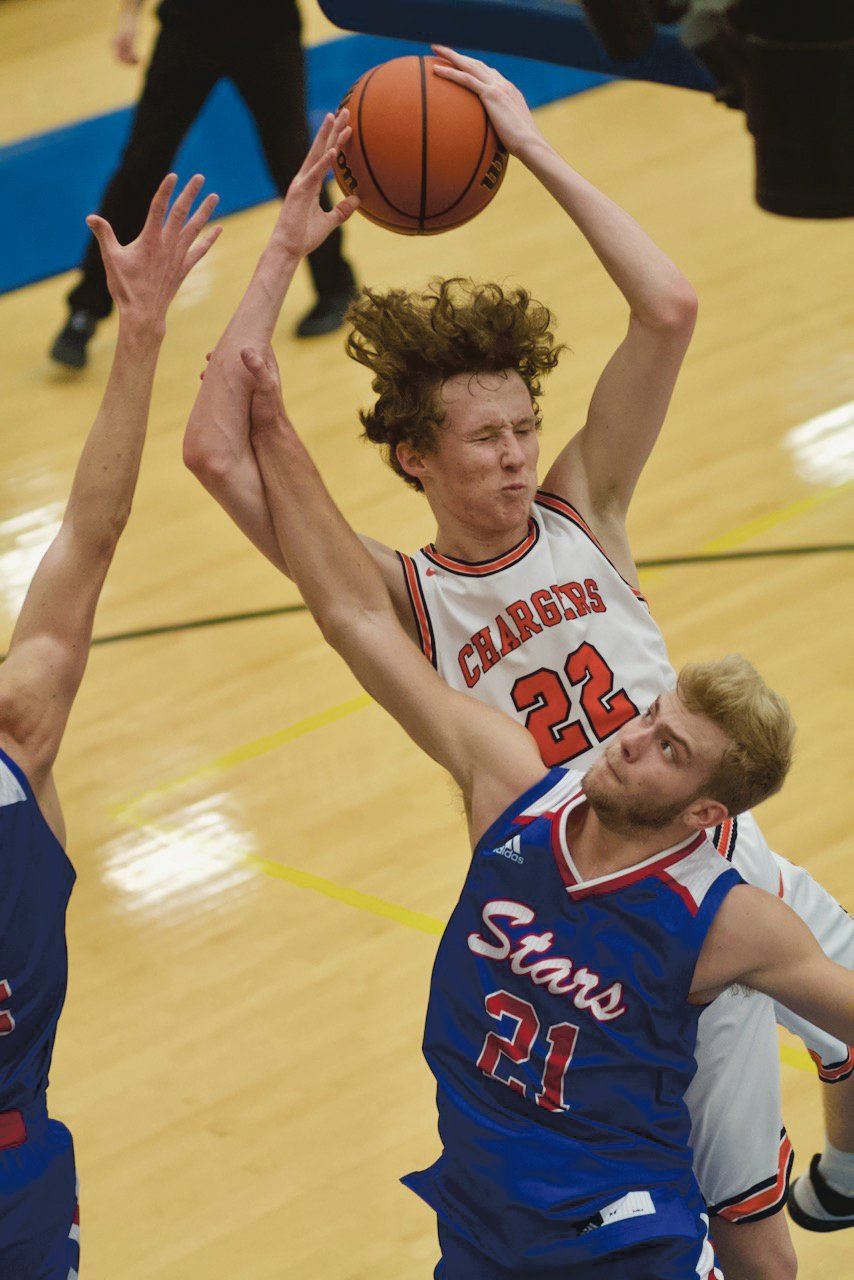 North Montgomery's Preston Shaw lskies over Western Boone's Spencer Wright for a rebound.