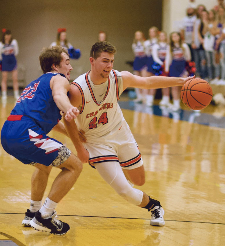 North Montgomery's Alex Wallace draws a foul from Western Boone's Connor Hole.