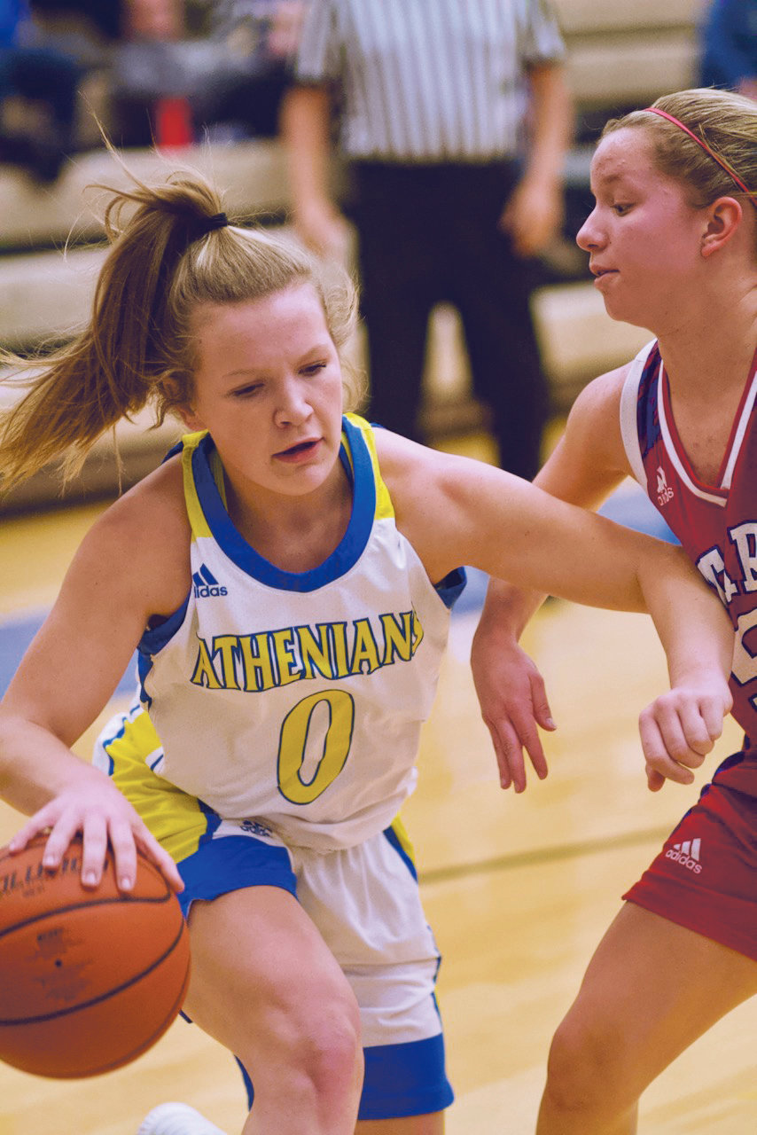 Olivia Reed drives to the hoop for the Athenians in a 40-31 loss to Western Boone on Tuesday night.