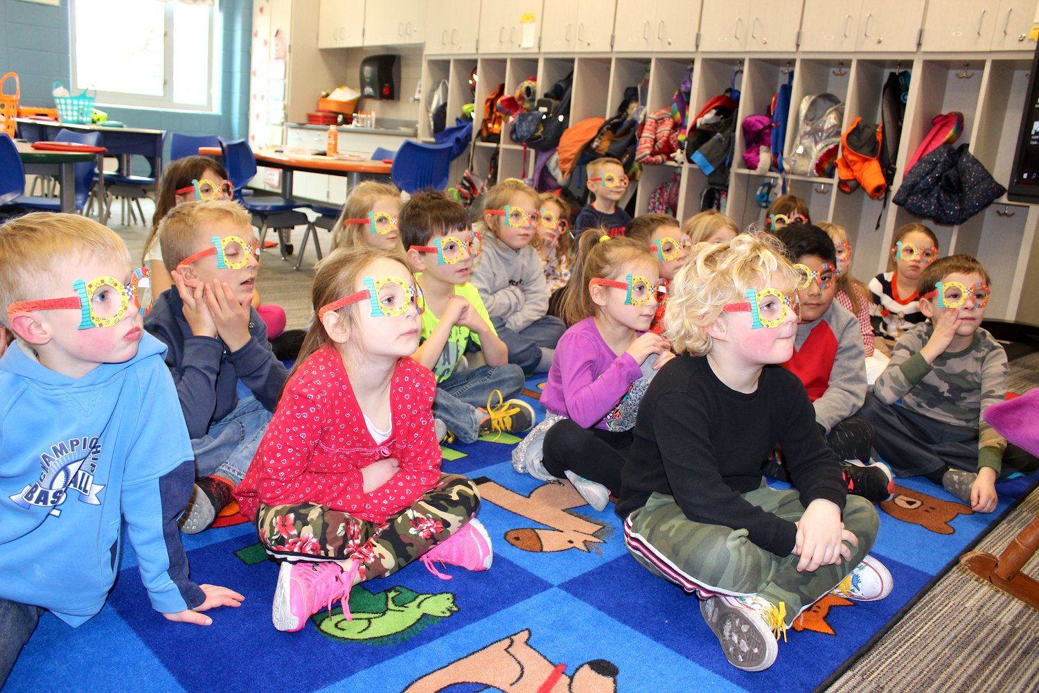 "Kindergarten students at Sommer Elementary listen to a story Friday while donning their ""100"" glasses to celebrate their 100th day at school."