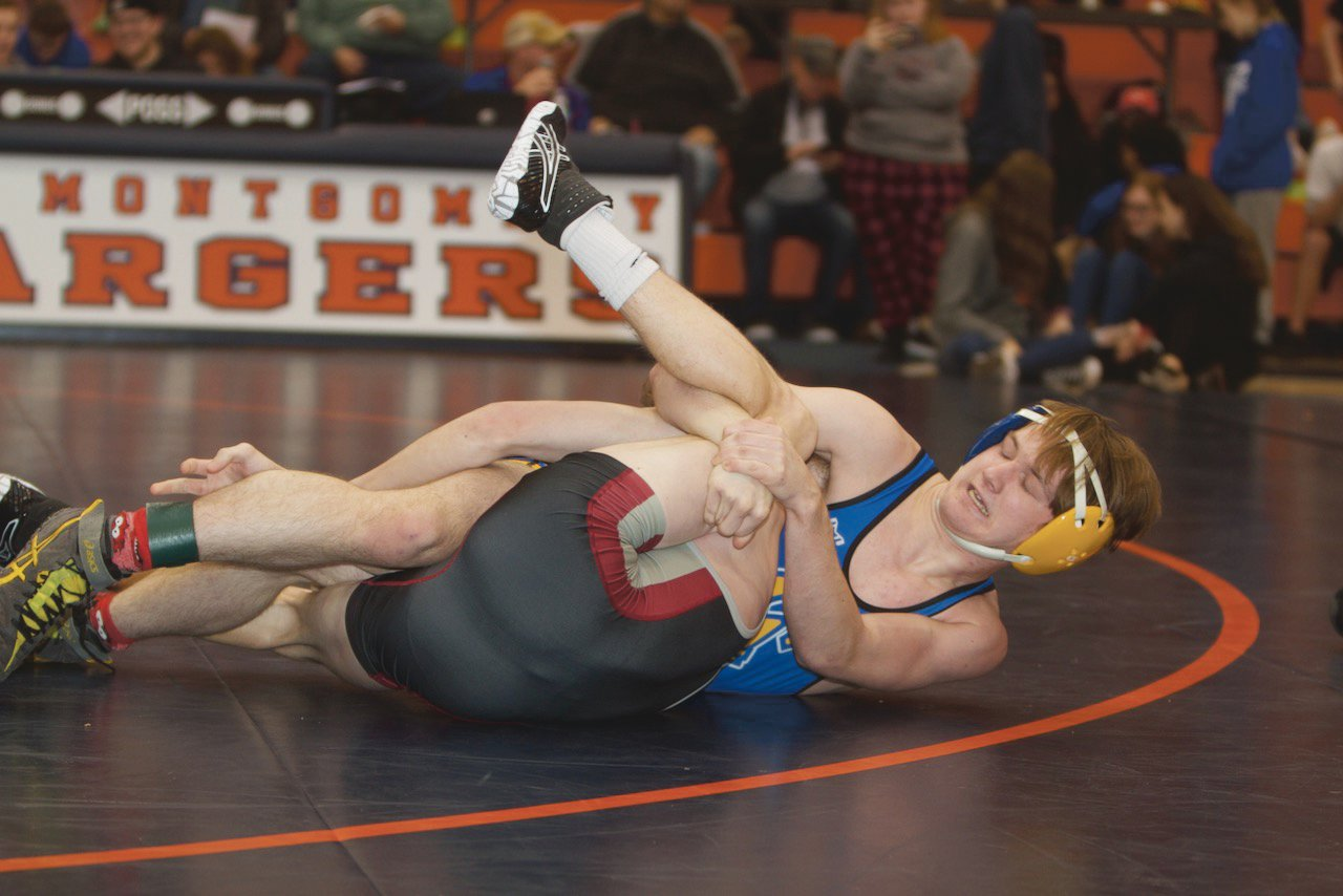 Crawfordsville's Alex Brown works on a pin against Danville's Nate Taylor.